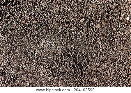 new black asphalt with stones as background .
