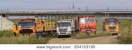 Kazakhstan, Ust-Kamenogorsk, august 18, 2017: Dump trucks