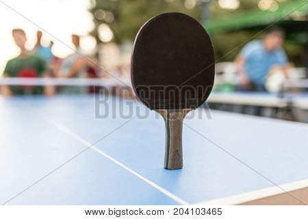 table tennis game with a blue table .
