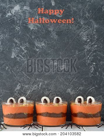 Funny dessert monster for Halloween on a gray background