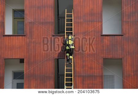 Firefighter Exercise While Climbing In The Fire Station