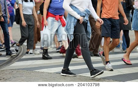 People Crossing The Pedestrian Crossing In The Busy Street Of Th