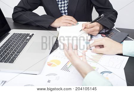 business accountant with document graph financial on office table. concept planning budget and audit.