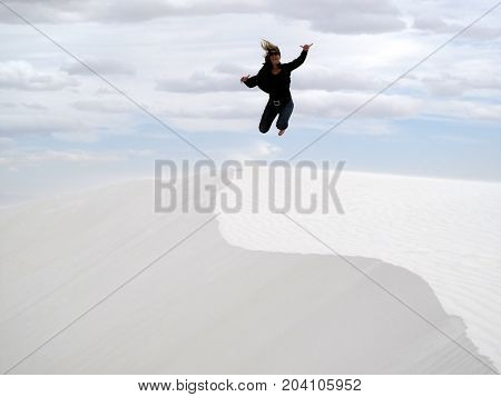 Woman jumping in White Sands National Monument, USA