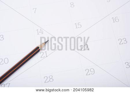 closeup pencil on calendar. organization management remind concept.