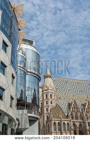 Vienna, Austria - August 16, 2017: Low angle view of the Cathedral of St Stephen in Vienna. Built in romanesque and gothic style, with its multi-coloured tile roof is one of the city's symbols