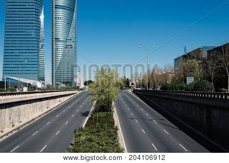 Madrid, Spain - June 25, 2017: Motorway in Cuatro Torres Business Area, CTBA Four Towers Business Area a business district in Madrid a blue sky day