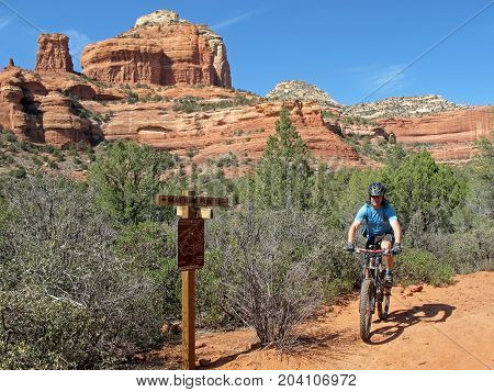 Mountain biker in the red rocks, Sedona, Arizona, USA