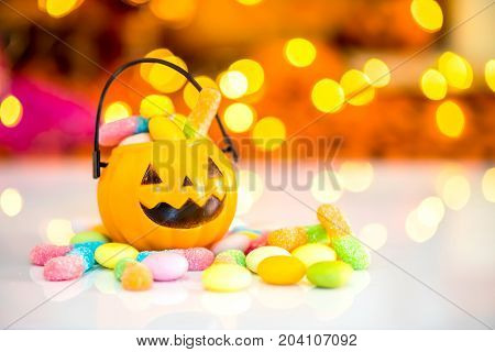Halloween pumpkin trick or treat with sweet candy