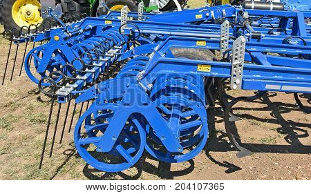 Harrow machinery at the agricultural fair oudoor