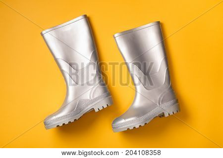 Silver Rain Boots On Yellow