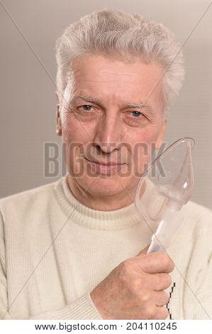 Close up portrait of Senior man  with inhaler