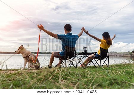 Young couple enjoy Camping Outdoors sky cleared in background . Holiday vacation summer concept .