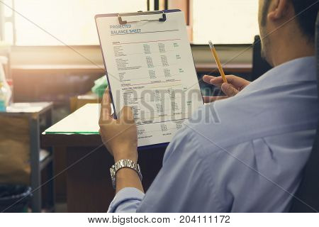 Business And Finance Concept Of Office Working, Businessman Discussing Projected Balance Sheet Chart