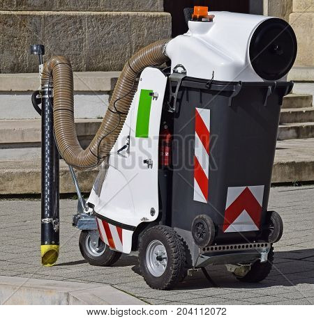 Vacum street cleaner machinery on the stree