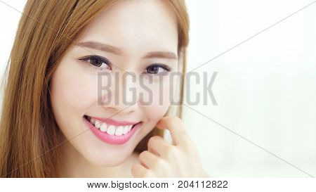 woman sit at home and smile happily