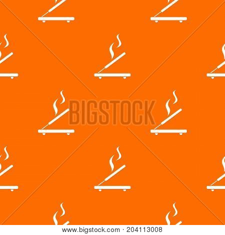 Incense sticks pattern repeat seamless in orange color for any design. Vector geometric illustration