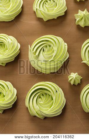 Home Baked Green Meringues Cookies. Top View