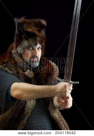 Cimmerian.barbarian Warrior.Medieval knight in the armor with the sword.