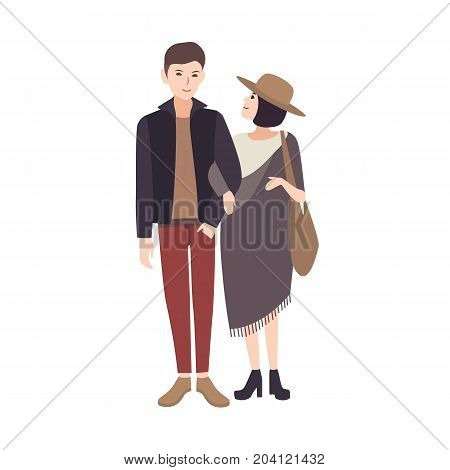 Young woman wearing fashionable poncho and hat standing beside smiling man, holding his arm and warmly looking at him. Elegant teenage couple. Pair of cartoon characters. Vector illustration