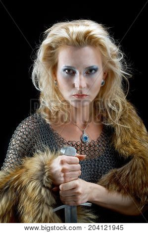 ancient  northern  Valkyrie. Viking girl with sword