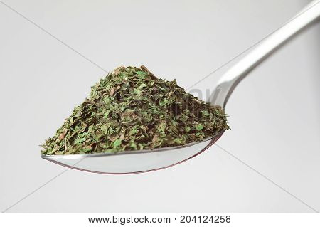 Spoon Of Green Dried Herbs