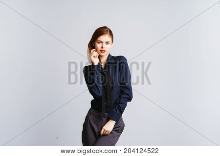 Attractive slender business woman, student in a suit and a dark shirt.
