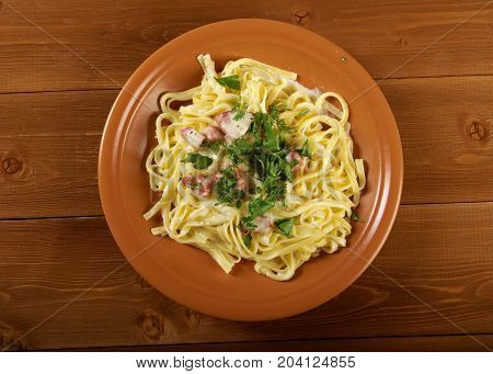 pasta Fettuccine Alfredo with sausage. , close up european meal