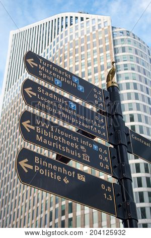 The Hague the Netherlands - 26 November 2016: street direction sign in The Hague with tall building in background