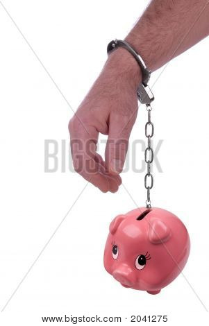 One Hand Handcuffed To A Piggy Bank