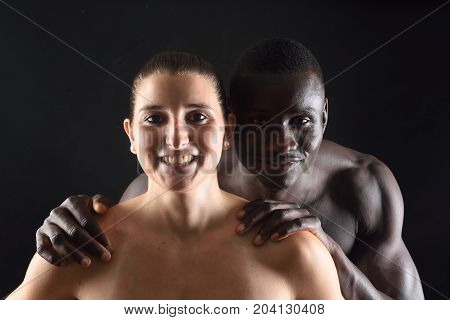 Portrait of a couple on black background