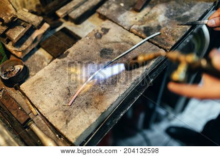 Jeweler Processing Metal