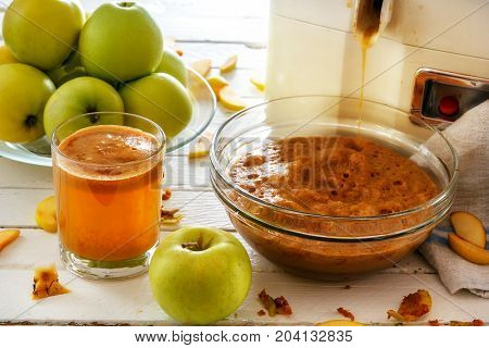 home-made apple juice, pressing fruit. fresh juice