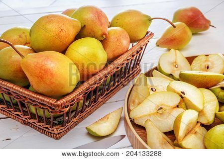 group of pears and half a pear on white wooden boards. Homework