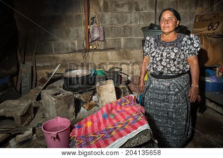 February 4 2015 San Pedro la Laguna Guatemala: portrait of a Maya woman standing in her kitchen in the small indigenous town