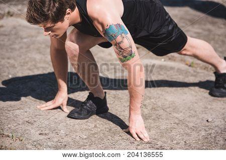 Man Stretching On Slabs