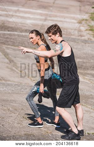 Sportive Couple Walking On Slabs