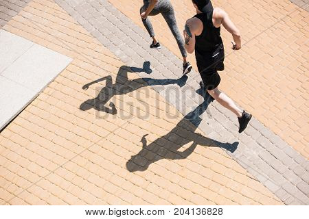 Couple Jogging On Street