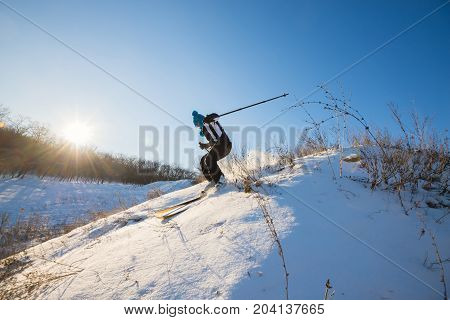 Girl Skier Fast Rides Downhill
