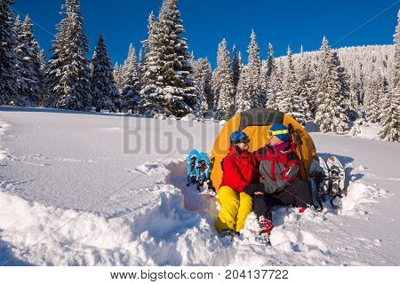 Happy Couple During The Winter Travel In Wilderness