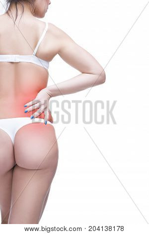 Young caucasian woman in underwear with backache pain in the human body isolated on white background with red dot copy space