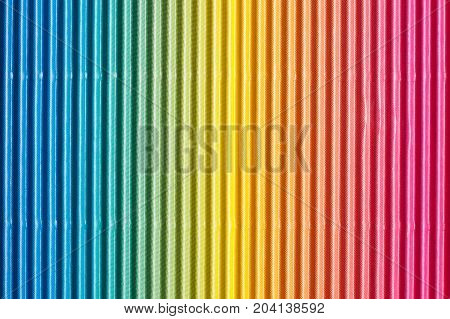 Colorful corrugated cardboard background. Striped colored paper texture.