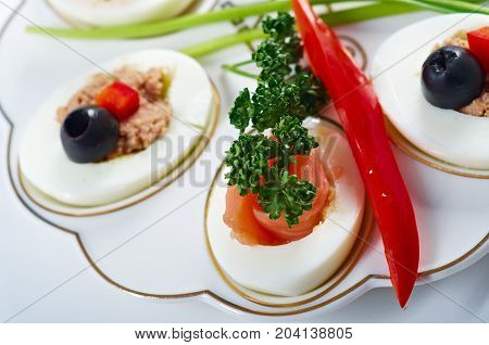 stuffed eggs with salmon close up healthy eating