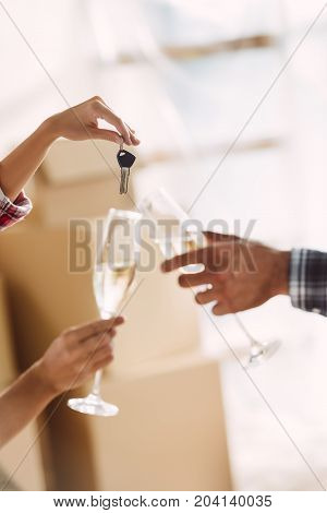 Couple Drinking Champagne In New House