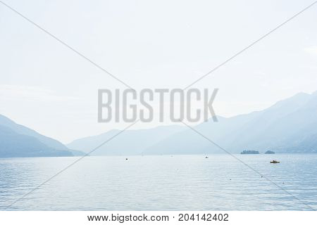 Boats on lago maggiore lake in ascona switzerland with mountain view landscape and water travel destination