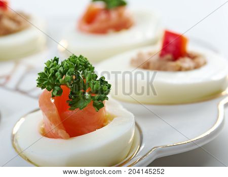 stuffed eggs with salmon and pate  , close up traditional meal