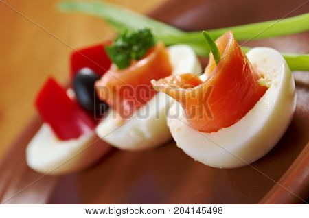 stuffed eggs with salmon pate  , close up traditional meal