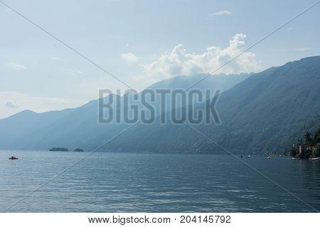 Lago Maggiore Lake with fog and Mountain landscape in Ascona Switzerland near Locarno