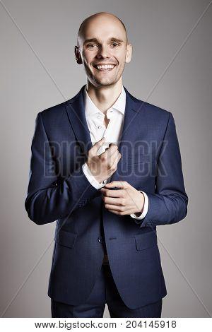 Man Fixing Cufflinks His Suit