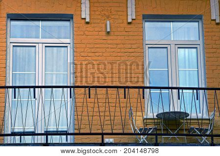 window and glass door on the wall with balcony and furniture